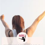 woman in ponytail raising hands toward sky
