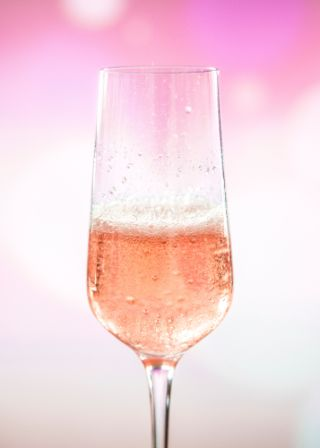Champagne glass filled with pink champagne symbolizing you should celebrate what you're passionate about