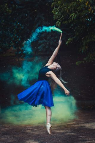 """ballerina surrounded in green smoke as she combats the thought, """"I don't know what to do with my life"""""""