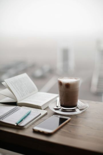 journal and coffee overlooking city, symbolizing you can do what you want with your life