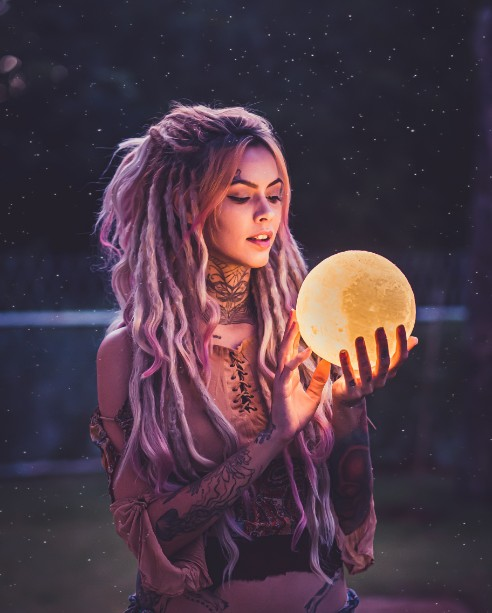 woman with crystal ball who knows how to manifest love