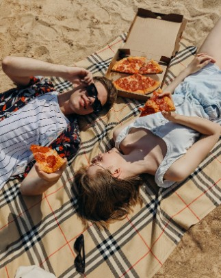 people eating pizza on a date