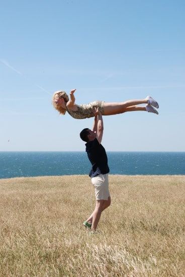 man lifting woman up into the air