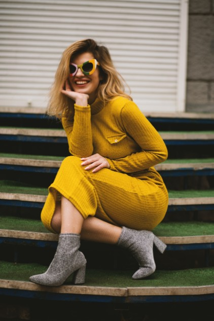confident woman in yellow dress